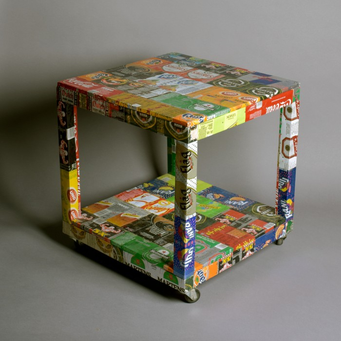 Recycled tin table on wheels